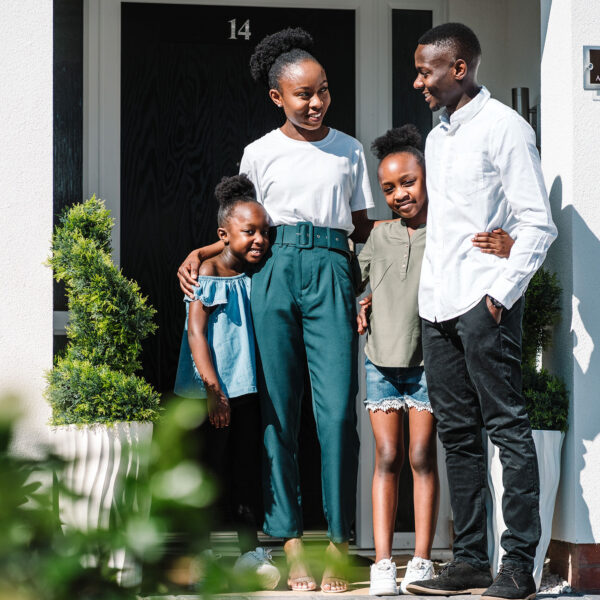 Family outisde home at Cofton Grange