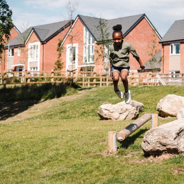 Girl playing at Cofton Grange