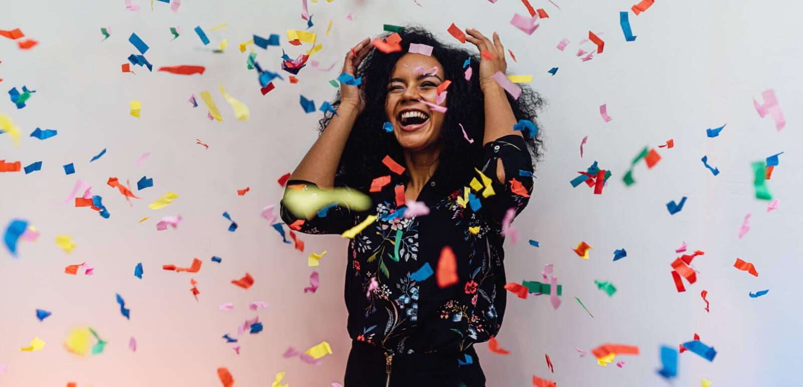 Woman celebrating in confetti